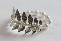 Silver Leaf Bracelet, Leaf Wedding Bracelet , Pearl Cuff bracelet, Pearl Bracelet, Leaf Branch Bracelet. $42.00, via Etsy.