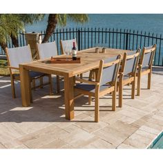 Outdoor Royal Teak Comfort Table 7 Piece Patio Dining Set with Captiva Sling Stacking Chair Moss Stacking Chairs, Outdoor Furniture Sets, Outdoor Decor, Teak Wood, Patio Dining, Dining Chair, Kitchen Dining, Furniture Websites, Furniture Stores