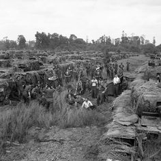 Camouflaged Churchill tanks of the 31st Tank Brigade which did not take part in Goodwood highlighting the efforts taken in Normandy to hide vehicles from enemy observers 13 July 1944.