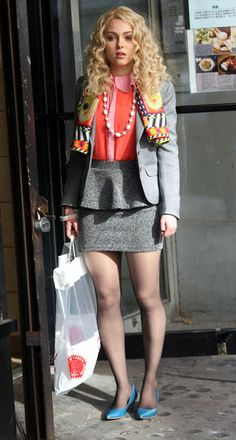Carrie (on the TV show, the Carrie Diaries) was all business in a tweed peplum skirt and matching blazer. Her punchy contrast-collar blouse, turquoise flats, and vibrant scarf added a splash of much-needed color. T