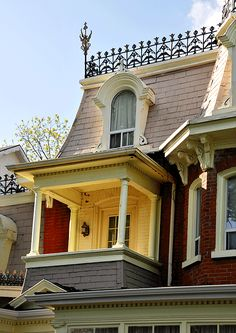small balcony and rounded dormer on Second Empire house in Ontario