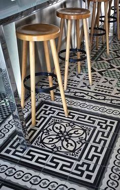 Starck  Philippe Starck designed a stunning hotel in France, and the hotel restaurant showcases loads of encaustic tiles throughout the space, again acting almost like area rugs to delineate different areas. This black and white design is uber-chic against all the contemporary furnishings.