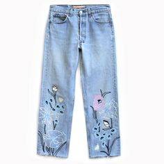 Bliss & Mischief Cropped Wildflower Jeans//Starting with hand-drawn flowers and rendered in chain stitch embroidery with a modern color palette and design, our Crop Wild Flower Denim features shades of ivory, light blue, navy and a pop of lilac on an authentic pair of vintage Levis 501s. This style is cut raw edge at the hem and features a cropped length.