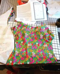 What's on your sewing table. #swimsuit #libertyfabric #bravobella pattern #thinkingofsummer #sewingsewqwkbravobella,grainlinestudio,libertyfabric,sewing,thinkingofsummer,swimsuit