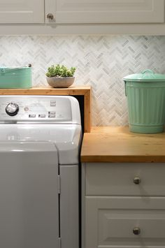Love this laundry room makeover. Faves are the countertop and mint trash can. Come Pet Our Tile: The Musical | Young House Love