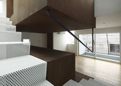 perforated metal stair, very innovating handrail.  IS / Yo Yamagata Architects