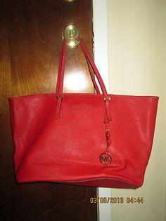 2d141cec48 Michael Kors Saffiano Medium Travel Handbag – Red is this america famous  brand michael kos