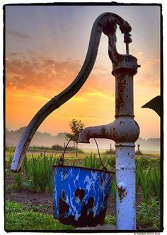 Sunrise on a memory from the past... the old hand pump, I remember those and a tin dipper that we all drank from, the water was sweet and cold!