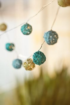 How do you take a dip in the ocean without getting a mouthful of saltwater? Easy. Pier 1's natural rattan string lights allow you to bring the sand-and-sea vibe straight to your backyard. Each LED orb has been painted blue and covered with glitter to resemble grains of sand. Just add batteries for an instant beachy accent.