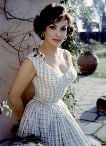Gina Lollobrigida. Someone once told me I looked like her, and I had no idea who she was. I think my waist is smaller ;)