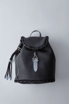 Acne Studios Rope Jungle black/light blue is a small leather backpack with large whipstitch details perfect for daily use.