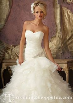 Romantic organza ball gown with fun and flirty ruffled skirt. Mori Lee Bridal Gown 1856