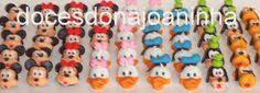 Doces modelados da turma Disney: Mickey, Minnie, Donald, Margerida, Pateta e Pluto.