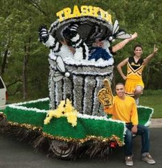 """You know you're going to trash 'em! Trash 'Em Float Kit includes trash can, football player, flies and yellow """"TRASH 'EM"""" letters. White and black areas on football player are as shown. High School Homecoming, Homecoming Spirit Week, Football Homecoming, Homecoming Parade, Homecoming Decorations, Homecoming Ideas, Prom, Homecoming Dresses, Parade Float Supplies"""
