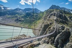 The Trift Bridge, Switzerland Located near Gadmen in the Swiss Alps, it is 560 feet long and 330 feet above the ground. Engelberg, Scary Bridges, Rickety Bridge, Formations Rocheuses, Destinations, Excursion, Belle Villa, Swiss Alps, Countries Of The World