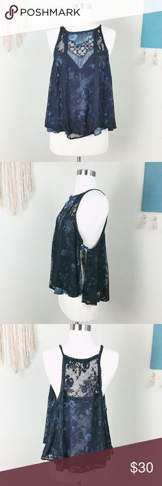 Free People Lace Side Tie Tank Top Gorgeous Free People Top. Delicate lace layered top of a blue floral pattern . Ties on the side. Pre owned in perfect condition. Free People Tops