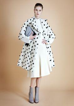 Céline coat, top, skirt, bracelet, and boots; Proenza Schouler bag.