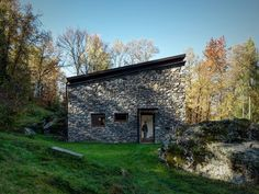 "13 Epic Alpine Retreats We're Swooning Over - Photo 4 of 13 - Architect Alfredo Vanotti sourced the home's stone exterior from the woods behind the property. ""I believe that mountain architecture is an emblematic example of sustainable architecture,"" he says. Reinforced concrete stands behind the stone facade to provide insulation. Vanotti wanted to focus this project on the simple materials of concrete, natural larch, iron, and wood."