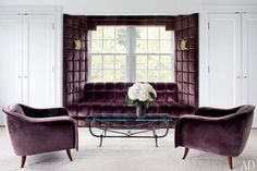 Lush Velvet Rooms interesting way to showcase a sofa.  Love the purple