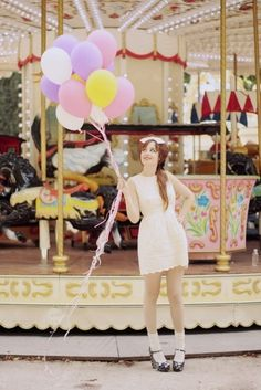 Love photos with balloons in them! Pick a cute outfit and take one in front of a merry go round