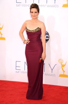 Va-Va-Voom! See the Sexiest Dresses to Hit the Red Carpet in 2012 : Tina Fey donned a figure-flattering gown with gold neckline detailing by Vivienne Westwood at the 2012 Emmys.
