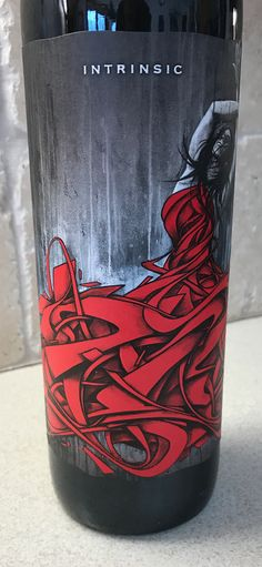Intrinsic wine label with woman in abstract red dress with a street art theme
