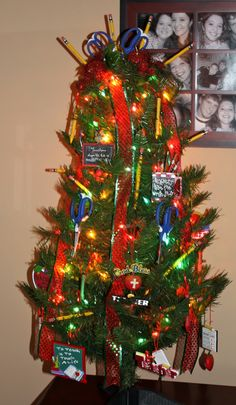 Teacher christmas tree! Complete with scissors, crayons, pencils, apples, and teacher ornaments!