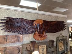 This majestic carved eagle is a gorgeous piece! Each individual feather carved with intricate detail across the impressive wingspan. This was meant to be a focal point on the wall of your cabin or home! Come down and admire this beauty in person!
