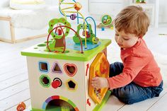 """""""The Country Critters Play Cube has four fun activities to keep children busy. The Animal Adventure Play Center is a shape sorting puzzle, a ball roller coaster, rotating maze and a tracking panel. Activity Cube, Activity Centers, Preschool Toys, Montessori Toys, Cubes, Country Critters, Play Cube, Best Educational Toys, Pranks"""