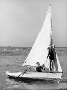 Couple on Small Sail Boat Photographic Print by George Marks at Art.com
