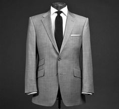 Gray suit, black tie, and a white pocket square - can't go wrong.