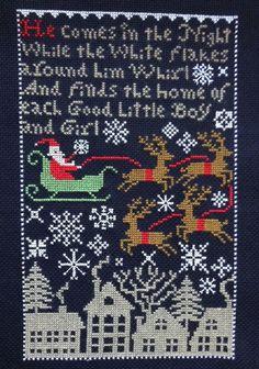completed cross stitch Prairie Schooler Christmas Santa sampler