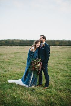 Bride wears a blue shawl | Photography by http://www.peachandjophotography.co.uk/