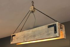 """Great looking wood beam chandelier with pulley & chains. Available in many different finishes and sizes. As pictured: 48"""" x 9"""" x 12"""" with 4 sockets. Bu"""