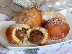 Nutella filled donuts – Italian style, Bomboloni alla nutella. Quick recipe that will show us how to prepare yummy Italian Nutella donuts, quick and easy to make, without long waits. You knead the pastry and fry them in a very short time. For the complete recipe click here: http://blog.giallozafferano.it/lacuci… To make Bomboloni (bombe) veloci alla …