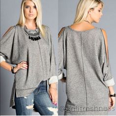 Last OneCold Shoulder French Terry Cut Out Top ----Two tone french terry cold shoulder cut-out top---Shoulder cut out down sleeve---High low hem---65% polyester 35% cotton---Made in USA---Relaxed fit/runs large---Price is firm---Free gift, of your choice, with retail purchase Tops Tees - Long Sleeve