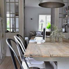 The top of this table looks like our scaffold board table...love the French cafe chairs too...