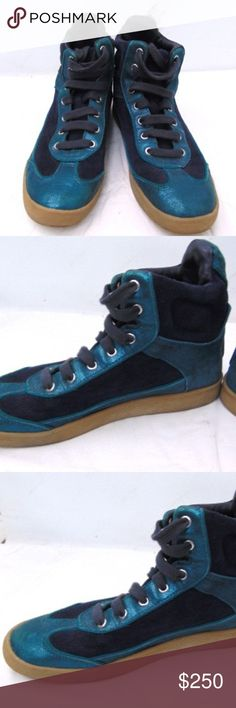 "Tory Burch Metallic Teal High Top Sneakers Size7.5 In Excellent Used Condition No Flaws Size: 7.5 Heel Height: 3/4""  Shoe Length: 9 1/2""    Shoe Width: 3 1/2"" Tory Burch Shoes Sneakers"
