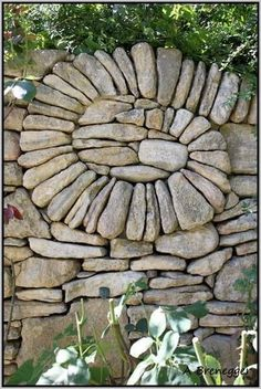 Stacked stone wall with curved element.what a beautiful use of stone.