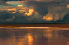 """""""Break in the clouds"""" by Malcolm Wells, taken after Cyclone Oswald, at Farnborough Beach."""
