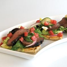 This small grazing salad piles big Greek flavor onto a trio of warm flat bread wedges.