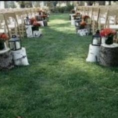 Wedding aisle - like the tree stumps & lanterns. Not sure if enough room? Doesn't need to be more than 1 at an aisle.