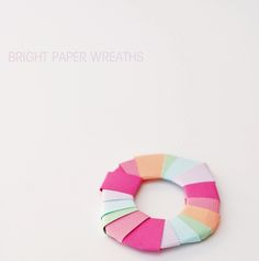 package wrapping with bright paper wreaths from A Subtle Revelry