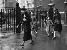 Princess Elizabeth and Princess Margaret, with their governess and a lady in waiting, walking from Tottenham Court Road Station to the headquarters of the Y.W.C.A. after their first tube train journey, on May 1939.