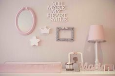 A neutral nursery with girly details. The choice of a textured grey wallpaper, allowed us to use everything we wanted in the decor.