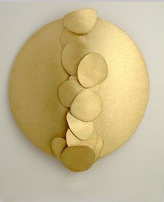 Brooch | Kate Bajic. 14kt yellow gold with free moving discs.