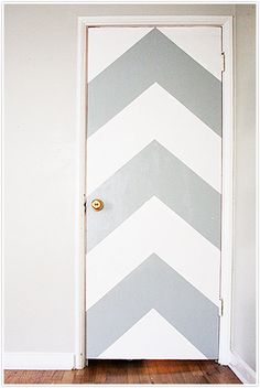 chevron pattern grey white neon door diy paint painting orange. Think I'll do this to each bedroom door. Different patterns on each. Maybe cream on white.