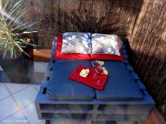 How to Make a Pallet Day Bed (too big, no railings, and not on wheels.... but potentially helpful info)