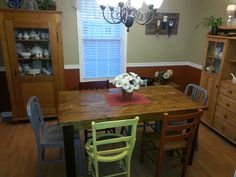 Farmhouse table w/ Honey satin stain. Two metal end chairs and different styles/colored side chairs.
