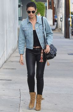 Lily Aldridge in Isabel Marant denim jacket, Paige tank top, and J Brand leather pants